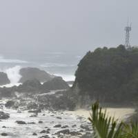 Waves pound the cape of Shionomisaki in Kushimoto-cho, Wakayama Prefecture, at 10 a.m. Sunday. | KYODO