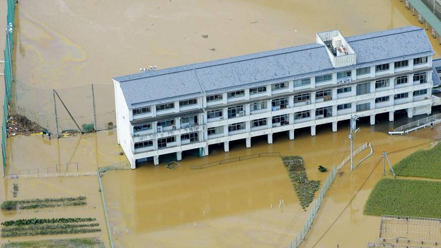 Kamodani Junior High School lies flooded after the Nakagawa River overflowed in Anan, Tokushima Prefecture, on Sunday.