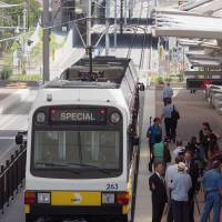 A light rail train stops at a station adjacent to Dallas-Fort Worth International Airport during a demonstration ride for the media in July. | KYODO