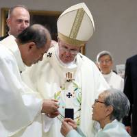 Pope Francis greets former 'comfort women' during Mass in Seoul