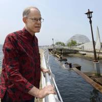 University of Tokyo professor Robert Geller looks at part of the Meriken wharf damaged by the 1995 Great Hanshin Earthquake and preserved at the Port of Kobe Earthquake Memorial Park. | KYODO