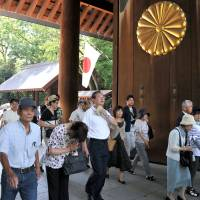 People are seen flowing into Yasukuni Shrine on Friday to pray for the war dead on the 69th anniversary of Japan's surrender in World War II.   | YOSHIAKI MIURA