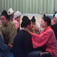 Making up for lost time: Okinawan university students prepare for a dance and music performance. With the last speakers of the Ryukyuan languages dying out, an identity is vanishing too. | PATRICK HEINRICH