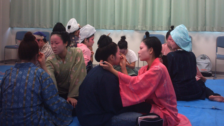 Making up for lost time: Okinawan university students prepare for a dance and music performance. With the last speakers of the Ryukyuan languages dying out, an identity is vanishing too.