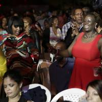 One love: Members of an audience at the Jamaican Jazz and Blues festival in Trelawny, Jamaica, on Jan. 30. | REUTERS