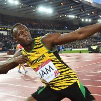 Bolt anchors Jamaica to gold in 4x100m relay