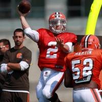 Manziel taking lumps in first camp