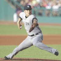Not out of the woods: Yankees pitcher Masahiro Tanaka has been sidelined since early July with an elbow injury. | AP