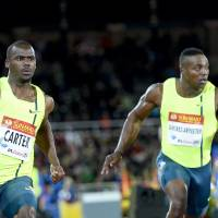 Diamonds are forever: Jamaica's Nesta Carter (left) wins the men's 100-meter race at the Stockholm Diamond League meet on Thursday. | AFP-JIJI