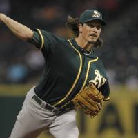 Fans 10 in win: Oakland's Jeff Samardzija fires a pitch against Houston in the third inning on Monday night. | REUTERS/USA TODAY SPORTS