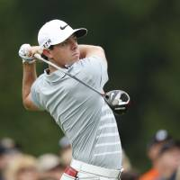 McIlroy beats Garcia, reclaims top ranking