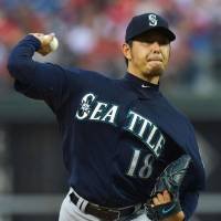 Man of the hour: The Mariners' Hisashi Iwakuma delivers a pitch against the Phillies on Sunday in Philadelphia. Iwakuma earned the victory, his 12th of the season. | KYODO