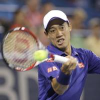 Game, set, match: Kei Nishikori hits a return against Lukas Lacko during their third-round match at the Citi Open on Thursday. Nishikori won 6-2, 2-6, 6-3. | AP