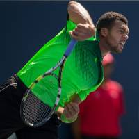 Tsonga caps stellar week by beating Federer in final