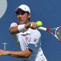 On to the next one: Kei Nishikori hits a shot against Pablo Andujar during their second-round match at the U.S. Open on Thursday in New York. Nishikori was leading 6-4, 6-1 when Andujar retired with an injury. | AFP-JIJI