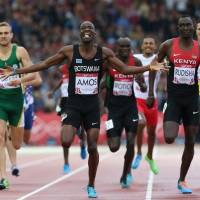 On the right track: Nijel Amos (center) begins to celebrate as he beats David Rudisha (right) to the finish line in the 800 at the Commonwealth Games on Thursday in Glasgow, Scotland. | AP