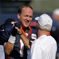 Manning having more fun at training camp