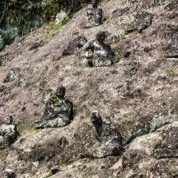 Esoteric resemblance: Stone statues line a hillside on the way to Reigando Cave. | ALON ADIKA