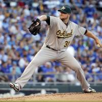 A-OK: Athletics starter Jon Lester pitches against the Royals on Tuesday in Kansas City. Oakland won 11-3. | AP