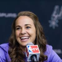 One step forward: Becky Hammon speaks during a news conference on Tuesday in San Antonio after joining the Spurs staff as the NBA's first full-time female assistant coach. | AP