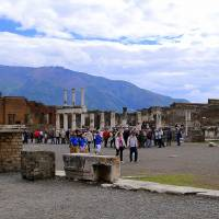 Threat of new extinction: Tourists stroll past the remains of Pompeii's forum. | AP