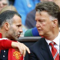 Stumbling start: Manchester United manager Louis van Gaal (right) confers with assistant Ryan Giggs during Saturday's Premier League opener against Swansea at Old Trafford. | REUTERS