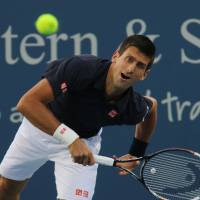 Djokovic survives shaky first match against Simon