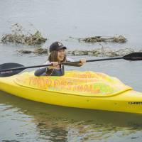 Taboo topic: Artist Megumi Igarashi paddles a kayak modelled on her vagina in the Tama River.  | REUTERS