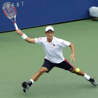 Nishikori powers into final 16