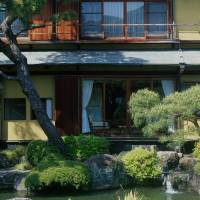 Rooms with a view: Kiun-Kaku is landscaped to accommodate full views of the garden from the rooms of the main house. Pictured here is the exterior of a room from when the main buildings served as part of a Japanese inn. | STEPHEN MANSFIELD