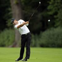 Tough at the top: Cameron Tringale hits a shot on the third fairway during the second round of The Barclays in Paramus, New Jersey, on Friday. | AP