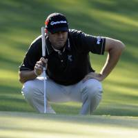 Palmer shoots 63 to grab early lead