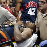 Road to recovery: Paul George is carried off the floor on a stretcher after injuring his leg during a U.S. team scrimmage on Friday in Las Vegas. | AP