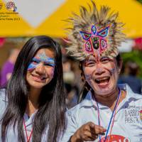 Fun from the Philippines: Staff welcome visitors to last year's Barrio Fiesta.