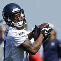 Back in action: Seattle Seahawks wide receiver Percy Harvin, making a catch during a recent training camp practice in Renton, Washington, missed most of last season with injuries. But he played in Seattle's Super Bowl triumph in February.  | AP