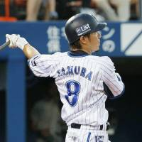 Solid pitching, 15-hit attack carry BayStars past Giants