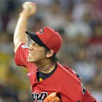 Dominating: Carp ace Kenta Maeda fans 12 batters in a 6-0 victory on Friday against the Hanshin Tigers at Mazda Stadium. |  KYODO
