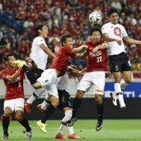 Nasu rescues Urawa point but Sagan take top spot