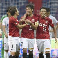 Pivotal play: Reds captain Yuki Abe (22) celebrates with teammates after scoring the match-winning goal in the first half against Sanfrecce on Saturday at Saitama Stadium. Urawa defeated Hiroshima 1-0.  | KYODO
