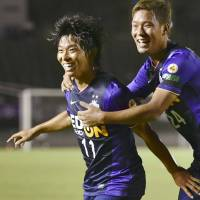 Up for the cup: Sanfrecce Hiroshima's Hisato Sato (left) celebrates with teammate Gakuto Notsuda after scoring in Wednesday's 1-0 Emperor's Cup win over Mito Hollyhock. | KYODO