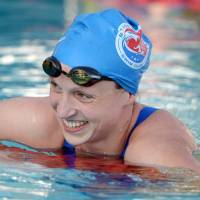 Weekend thrill: Katie Ledecky flashes a smile after setting a world record in the women's 400-meter freestyle on Saturday in Irvine, California.  | REUTERS