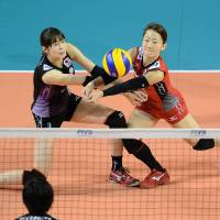 Working together: Saori Kimura (left) and Yuko Sano stay focused on the ball during Thursday's match against Turkey. | FIVB