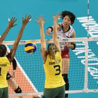Not enough: Yuki Ishii wins a point for Japan during their defeat to Brazil in the FIVB World Grand Prix on Sunday. | FIVB