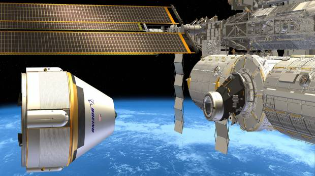 SpaceX, Boeing land NASA contracts to carry astronauts to space