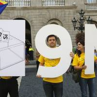 Catalan leader orders referendum on independence from Spain, buoyed by close vote in Scotland