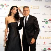 Clooney says he'll wed fiancee in Venice