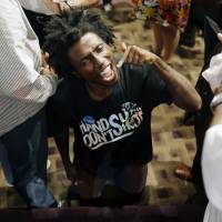 Protests, anger, doubt prevail at Ferguson meeting