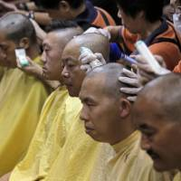 Hong Kong pro-democracy leaders shave heads in protest