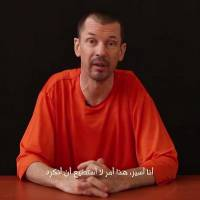 Islamic State shows British hostage in new 'program' video
