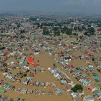 Police in Indian Kashmir collect bodies floating in worst floods in years